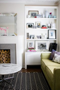 love the logs in the fireplace (would be good for our useless AZ fireplaces!)