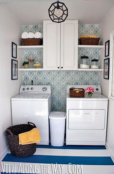 Add some brightness to your laundry room - this white space gets a colorful lift from the graphic glue and white wallpaper on the back wall.