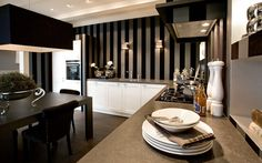 Bold black stripes with white cabinetry make for a rich, luxurious kitchen design. From SieMatic's City Country line.