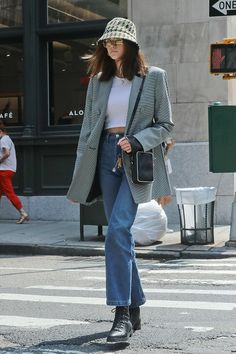 Kaia Gerber in an Alexander Wang blazer, Cruz Jimmy Choo boots paired with a Prada bucket hat and bag, June Source by footwearnews invierno Rihanna Street Style, Model Street Style, Casual Street Style, Berlin Street Style, Looks Street Style, Autumn Street Style, Street Style Women, Street Styles, Models Style