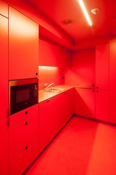 Colour coding has been used throughout the office space, with green used for the walls and desk in the foyer. Staff kitchens are finished in red and blue, with matching corridors and doors.
