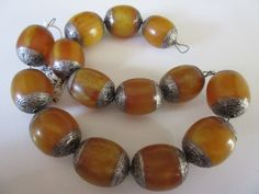 String of large Amber/Mila beads that are capped with silver ends. Very beautiful material, 19th century, Tibet