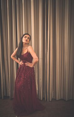 Stunning marsala cocktail gown with a thigh slit and beautiful crystal work all over | WedMeGood| Lalima & Siddhant|#wedmegood #indianweddings #gown #cocktailgown #marsala #jeweltones #cocktailparty