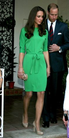 Middleton stopped by a reception at the British Consul-General's residence wearing a belted emerald green dress and a leopard-print clutch, both by Diane von Furstenberg.