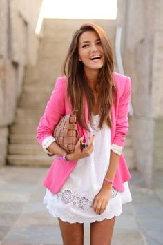 a hot pink blazer paired with a flowy white dress