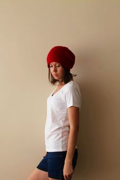 Hand knitted red hat made with acrylic and wool yarn.  Soft and very stylish.  Has a perfect fit! One size fits all.