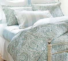 She sells seashells by the seashore (Painterly Paisley 400-thread count duvet cover and sham in Porcelain Blue from Pottery Barn, $39-179)