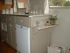 Trailer remodel. I like the kitchen space. needs a toaster oven. that shelf could be made into a two person table.