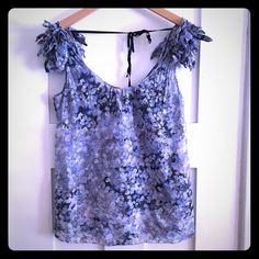 Banana Republic top Many different shades of blue and violet, jagged ruffles on shoulder straps, string across back that ties at neck, snaps inside the straps to go around your bra straps, very thin cotton, lined. Banana Republic Tops