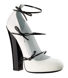 L Vuitton...I couldn't never wear a heel like this not to mention never afford them but damn so cute