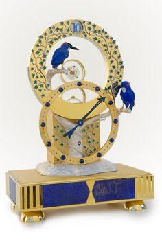 """Frank Jutzi Mysterious Tourbillon Clock.The central idea of this clock is the mysterious tourbillon. The handmade 8-days movement drives mysteriously the """"flying"""" tourbillon thanks to a visible wheel. The minutes are shown by a minute-hand whereas the hours appear on the top in a window on the ring in the upper part of the clock."""