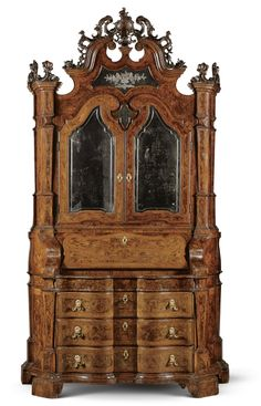 An Italian fruitwood inlaid walnut and burr walnut bureau cabinet, Venetian,mid 18th Century.