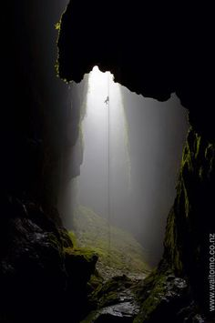 Rappelling Into The Lost Cave. Photographer Chris McLennan captures Johnny Tate's 330 foot abseil into the Lost World Cave in New Zealand's Northern Island Oh The Places You'll Go, Places To Travel, Beautiful World, Beautiful Places, Beautiful Islands, Amazing Places, The Lost World, Rappelling, Adventure Is Out There