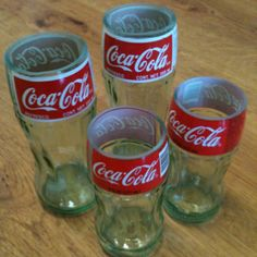 Coca-Cola Coke drinking glasses made out of empty soda bottles. Recycle, repurpose, upcycle. Facebook.com/FHJLR
