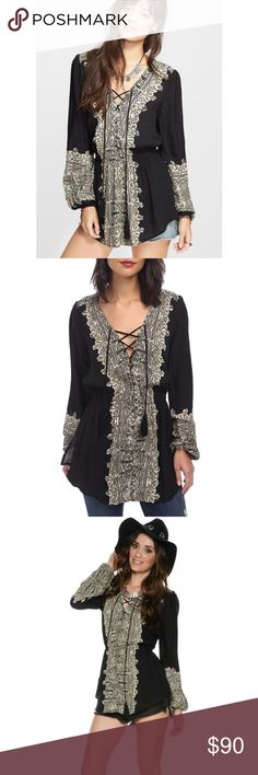 """Free People Wilder Moment Tunic Voluminous bishop sleeves profile a bohemian, lace-up printed tunic that resonates in chic renaissance style. 29"""" length (size Medium). Front lace-up detail. 60% viscose, 40% rayon. Gently used. Offers welcome. Free People Tops Tunics"""