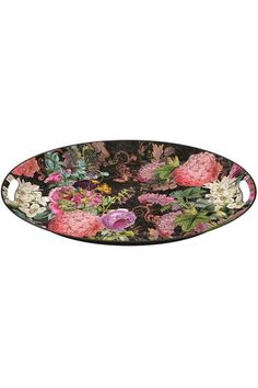 This beautiful metal tray features the Botanical Garden design from Michel Design Works. The visual design is a harmonious union of modern and retro styles, with colorful peonies and roses contrasted against a chalkboard colored background. These charming metal trays are oval shaped and made of lightweight metal. It even has built-in handles for easy carrying. It is practical to use, easy to store, and always beautiful. It is a nice addition to your entertaining events, whether used indoors…