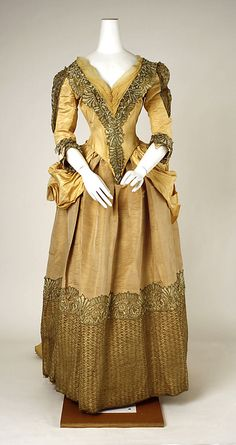 Dress  Date: 1885–89 Culture: American Medium: silk, metallic thread, cotton Dimensions: Length (a): 17 in. (43.2 cm) Length at CB (b): 58 in. (147.3 cm) Credit Line: Purchase, Marcia Sand Bequest, in memory of her daughter, Tiger (Joan) Morse, 1978 Accession Number: 1978.295.4a, b  This artwork is not on display