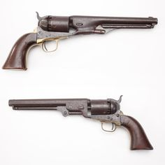 Colt Navy Revolvers - At the start of the American Civil War, Colt decided to bring along a more streamlined piece than the Model 1851, the Model 1861 with a round barrel. The two .36 caliber percussion handguns were on tap for military orders.  By late 1865, almost 28,000 M1861 Colts had been manufactured.  But both of the Navy models continued in production until 1873. At the NRA National Firearms Museum in Fairfax, VA.  http://goo.gl/kpeoml