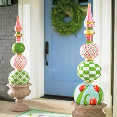 Make your spring and Easter greeting stand apart from the rest with our colorful and elaborately decorated Spring Tulip Topiary. You'll only find it here. A striking accent and unexpected touch of grandeur that put your great designer taste on prominent display. Three graduated orbs are embellished with tulip and harlequin patterns, topped with a solid sphere of perfect pink. A coordinating, multicolored finial beautifully accentuates the symmetry. Decorate urns, or place directly on the…