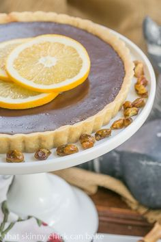Semisweet Chocolate Tart   Semisweet chocolate tart with a buttery crust and a touch of Grand Marnier from  @lizzydo: