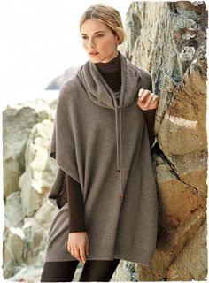 Echoing the look of a poncho, this luxurious pullover is knit of snuggly-soft, woolen-spun royal alpaca. Drop shoulders; open sleeves; sculptural cowl with beaded drawstrings.
