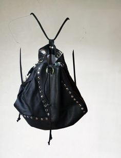 Black backpack is made of pieces of natural leather, it's a proposition for people who value usabilty of backpack, its functionality and originality. It's perfect for every...