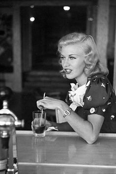 Ginger Rogers - I wonder if this was taken at the soda fountain she had built inside her house ?