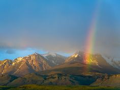 Bright Rainbow over Andean Valley