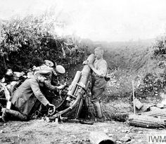 WWI, Italian Front; German gunners loading a 17 cm medium trench mortar (17 cm mMW) with a shell. © IWM (Q 23710)