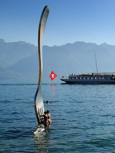 giant fork (over 500 kg - 1100 pounds ) planted in Lake Geneva in front of Alimentarium Food Museum, Vevey, Switzerland