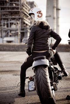 Blonde girl on a motorbike dressed in leather