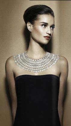 wow. beautiful. azza fahmy. middle eastern influences. Love collar necklace tho would need burnished version. Im adding this b/c im going to pretend it burnished. Really like the look for strapless.  A LITTLE TOO CLASSIC, esp hair & boring dress, tho necklace is outstanding,