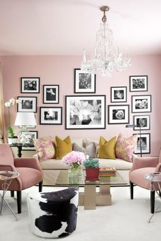 love the femininity expressed in this room but like the edge of the cowhide, black & white pics & ochre tossers.