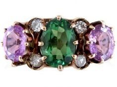 A diamond and tourmaline ring, c.1901-14; the green, purple and white stones symbolise the suffragette movement. (The Antique Jewellery Company)