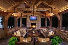 An outdoors design collection which features 18 Spectacular Rustic Porch Designs Every Rustic House Needs To Have. house 18 Spectacular Rustic Porch Designs Every Rustic House Needs To Have Rustic Outdoor Fireplaces, Outdoor Fireplace Designs, Backyard Fireplace, Small Fireplace, Cabin Homes, Log Homes, Timber Homes, Outdoor Rooms, Outdoor Kitchens