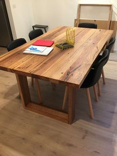 Solid recycled timber dining table with box legs. Made of locally-sourced mixed Victorian hardwoods and inished with a food-safe natural wax.