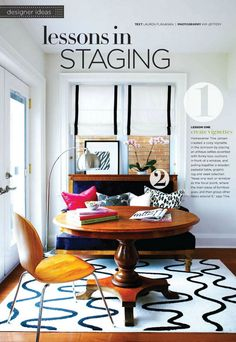 Basics: white and wood. Black and white prints on curtains/rugs/pillows. Accents: royal blue and bright pink.