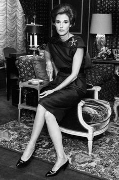 Babe Paley in a navy silk surplice black dress from Givenchy, a sapphire and emerald ring and a Schlumberger starfish pin of sapphires, emeralds and diamonds on her shoulder, 1963.