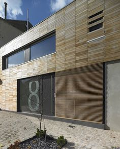 Mesmerizing Inspirations for Modern Home Design: Cool Krtmrg Home Design Exterior With Wooden Wall Decoration Ideas Combined With Glass Sliding Door For Home Inspiration To Your House ~ HOMESBRO Architecture Inspiration