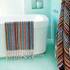 """Loomed cotton bath mat with hand-tied fringe. Made in Turkey.   Product: Bath matConstruction Material: 100% CottonColor: Blue and multiFeatures: Made in TurkeyHand-tied fringesDimensions: 22"""" x 36""""Cleaning and Care: Machine washable. Tumble dry low."""