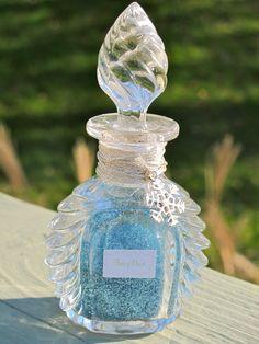 A OOAK bottle of blue Fairy Dust by Whimsical Properties .