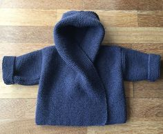 Knitting Pattern for Easy Baby Hooded Wrap Cardigan - Quick and easy hoodie in garter stitch in 3 sizes to fit chest: 41(46:51)cm, 16(18:20)in. Ages:0-3m(3-6m:6-12m). Designed by Audrey Wilson. Pictured project by parksidepurler