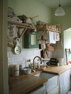 the cabinet above the sink is such a cute idea!
