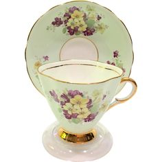 This lovely Mint Green Teacup and Saucer by Clarence Bone China, Longton, England, with its Purple and Yellow Flowers is a breath of spring! This