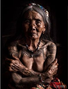 """a picture of Whang-Od who is the oldest Kalinga """"mambabatok"""" or tattoo artist at 97 years old. The picture has been accompanied by a message which read: """"Whang-Od is the last Ancient Kalinga Tattoo artist."""