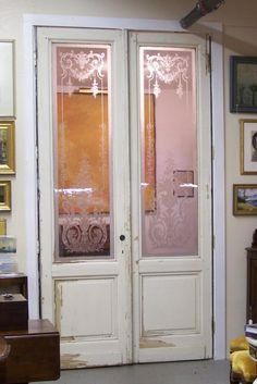 Pair of French blown glass doors from ParisEach door measures 111 inches tall, 30 inches wide and 1 and seven eighths inches thick.