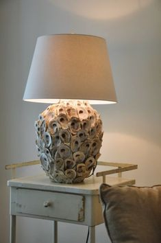 Oyster shells on old lamp. Who would ever have thought something that used to be used as driveway material around these parts could turn an ugly old lamp into a conversation piece? Oyster Shell Crafts, Oyster Shells, Sea Shells, Seashell Art, Seashell Crafts, Beach Crafts, Starfish, Coastal Living, Coastal Decor