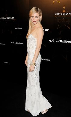 Sienna in a white Christian Dior gown at an event in 2011.