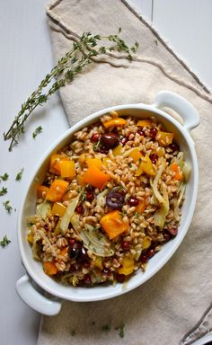 This jewel-toned side dish will have everyone talking. The nutty farro, fennel and bell peppers get sweeter with roasting, the briny notes of Kalamata olives add depth, and the texture is heightened by the juicy pomegranate seeds. Perfect for a healthy Thanksgiving side! // thanksgiving recipes // beachbody // beachbody blog