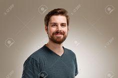 Портрет улыбается молодой человек с бородой, на нейтральном фоне Фотография, картинки, изображения и сток-фотография без роялти. Image 49349080.
